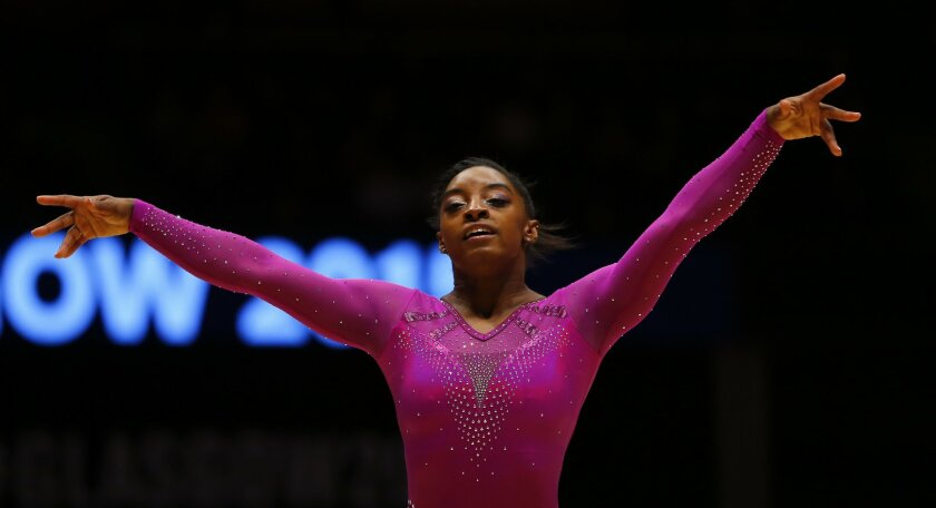Winner Simone Biles of the U.S. performs during the floor exercise at the women's apparatus final competition at the World Artistic Gymnastics championships at the SSE Hydro Arena in Glasgow, Scotland, Sunday, Nov. 1, 2015. (AP Photo/Matthias Schrader)