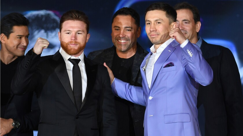 Canelo Alvarez and Gennady Golovkin pose for photos during a news conference on Feb. 27 at L.A. Live to advance their rematch.