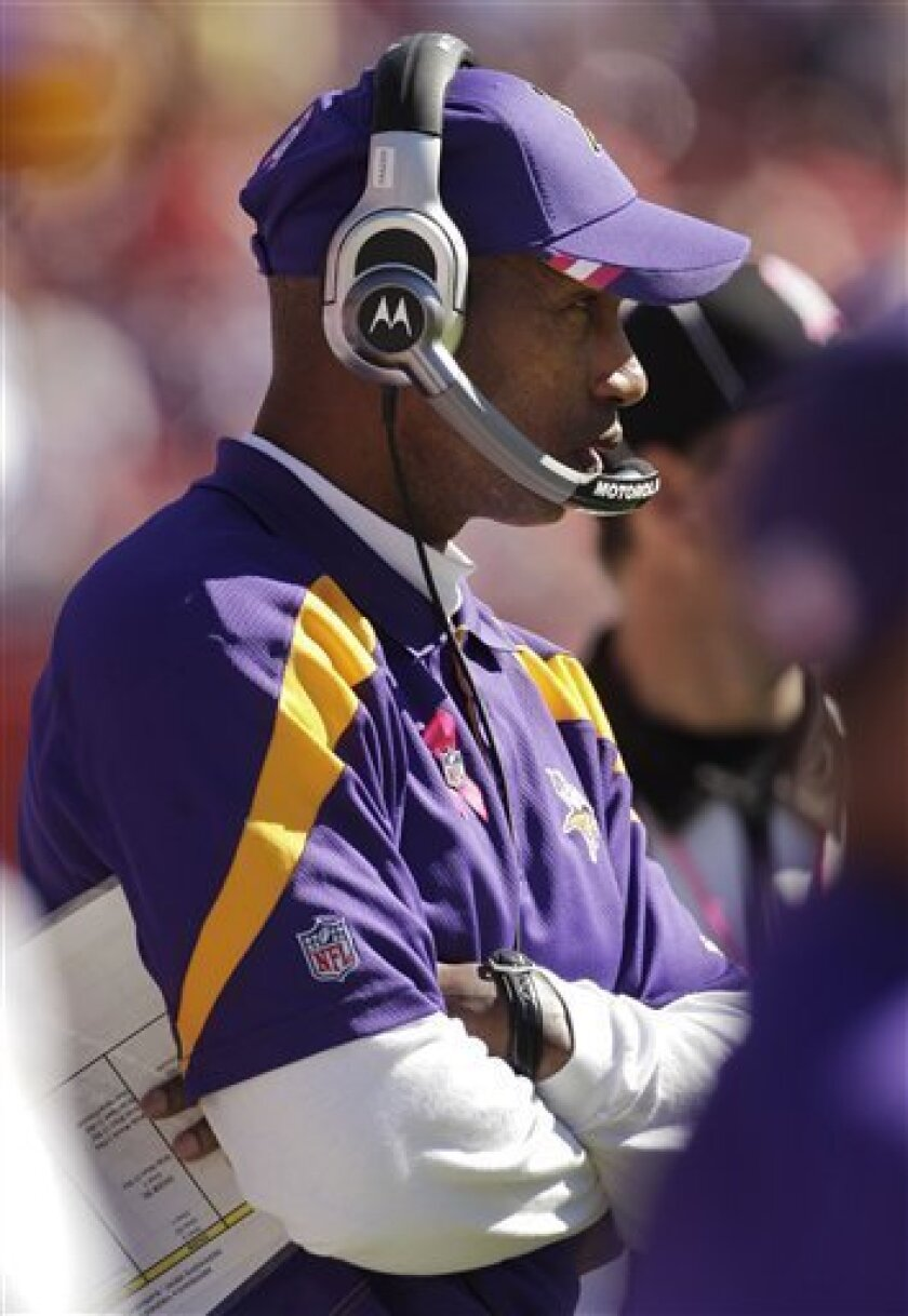 Minnesota Vikings coach Leslie Frazier watches from the bench during the second half of an NFL football game against the Kansas City Chiefs at Arrowhead Stadium in Kansas City, Mo., Sunday, Oct. 2, 2011. The Chiefs defeated the Vikings 22-17. (AP Photo/Charlie Riedel)