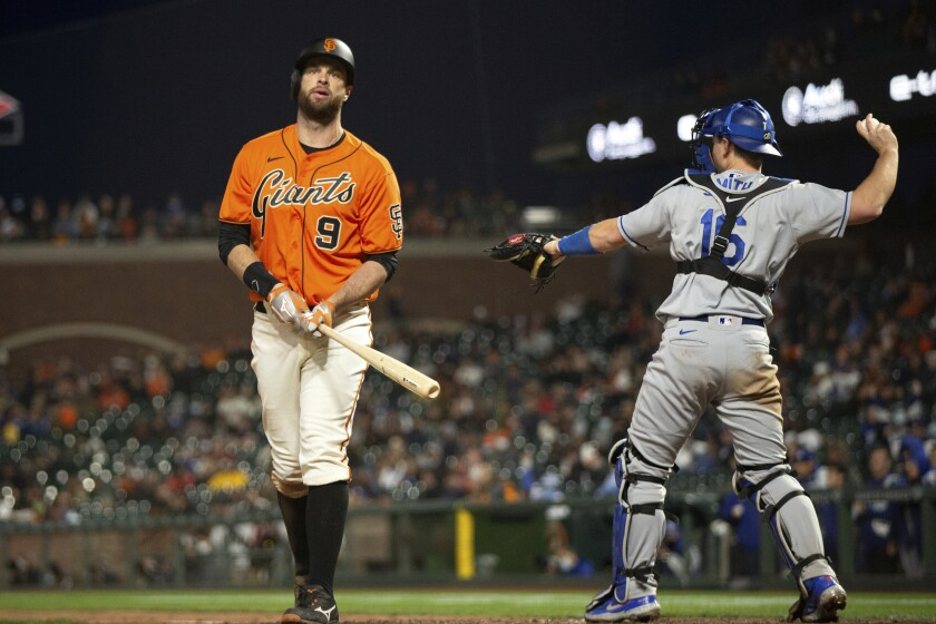 The Giants' Brandon Belt (9) reacts to striking out against the Dodgers.