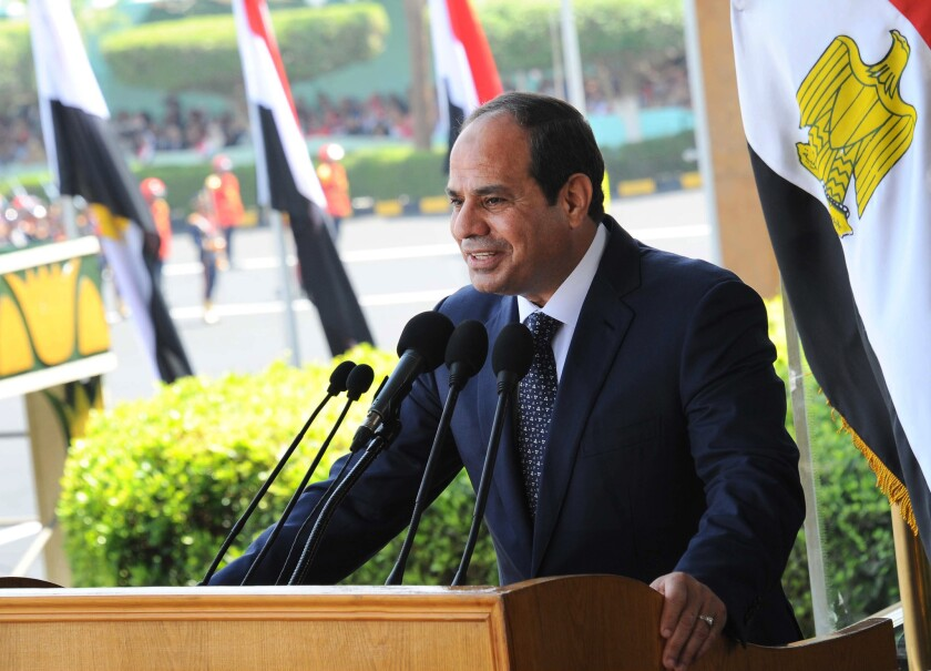 "Egyptian President Abdel Fattah Sisi speaks at a military graduation ceremony in Cairo Tuesday. Sisi said he will not ""interfere"" in the case against three Al Jazeera journalists sentenced to prison terms."
