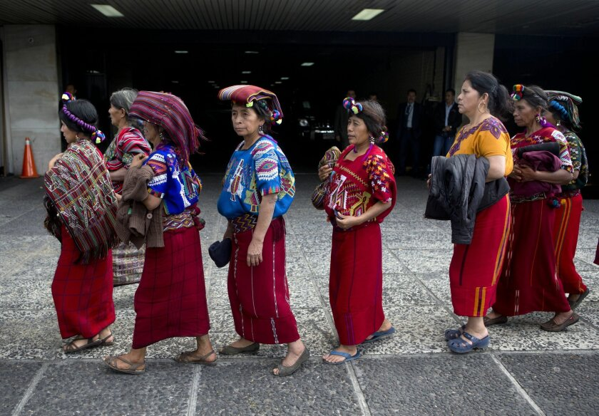 Indigenous women from the Ixil and Quiche ethnic groups arrive for the trial of former police officer Pedro Garcia Arredondo in Guatemala City, Monday, Jan. 19, 2015. Arredondo was found guilty for the murder of 37 people who died in the 1980 attack and burning of Spain's embassy in Guatemala. Acco