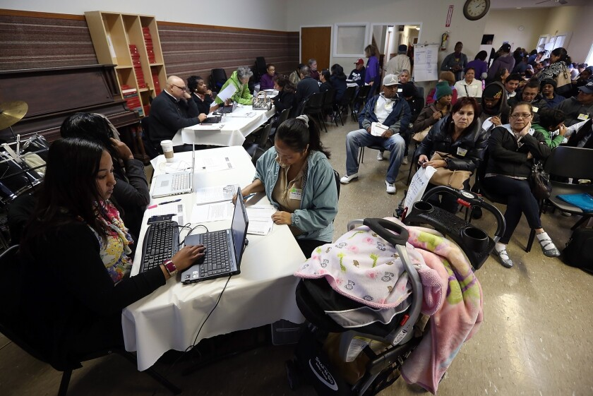 Workers help applicants register for Medi-Cal in Richmond, Calif.