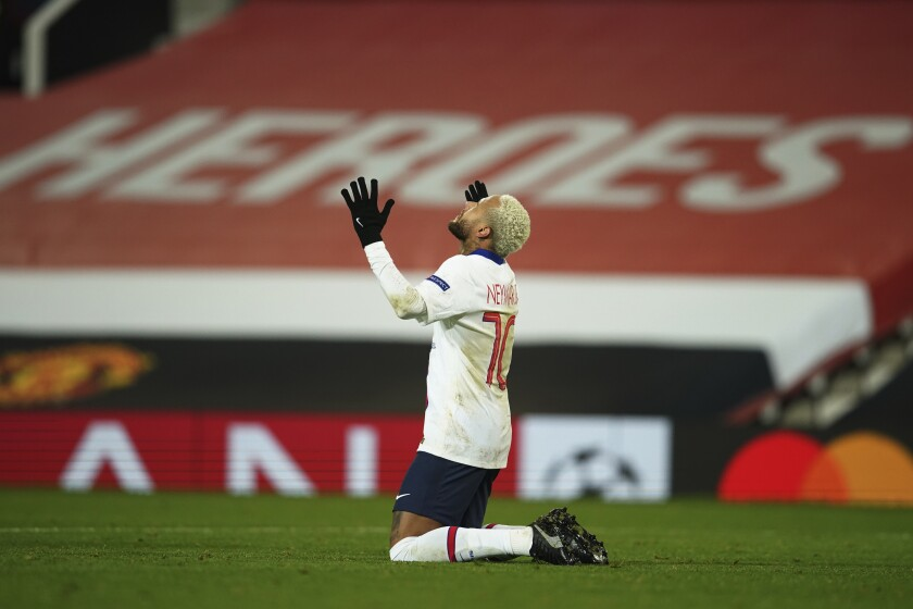 PSG's Neymar celebrates after scoring his side's third goal during a Group H Champions League soccer match between Manchester United and Paris Saint Germain at the Old Trafford stadium in Manchester, England, Wednesday, Dec. 2, 2020. (AP Photo/Dave Thompson)