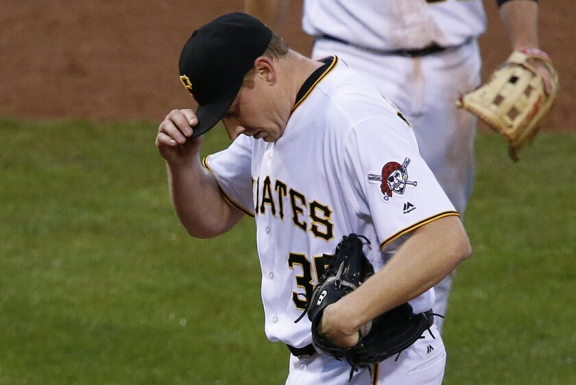 Pittsburgh Pirates relief pitcher Mark Melancon collects himself on the mound after giving up a single to Colorado Rockies' Tony Wolters that drove in one run and allowed another to score on an error on Pirates first baseman John Jaso in the ninth inning of a baseball game in Pittsburgh, Saturday, May 21, 2016. The Rockies won 5-1. (AP Photo/Gene J. Puskar)