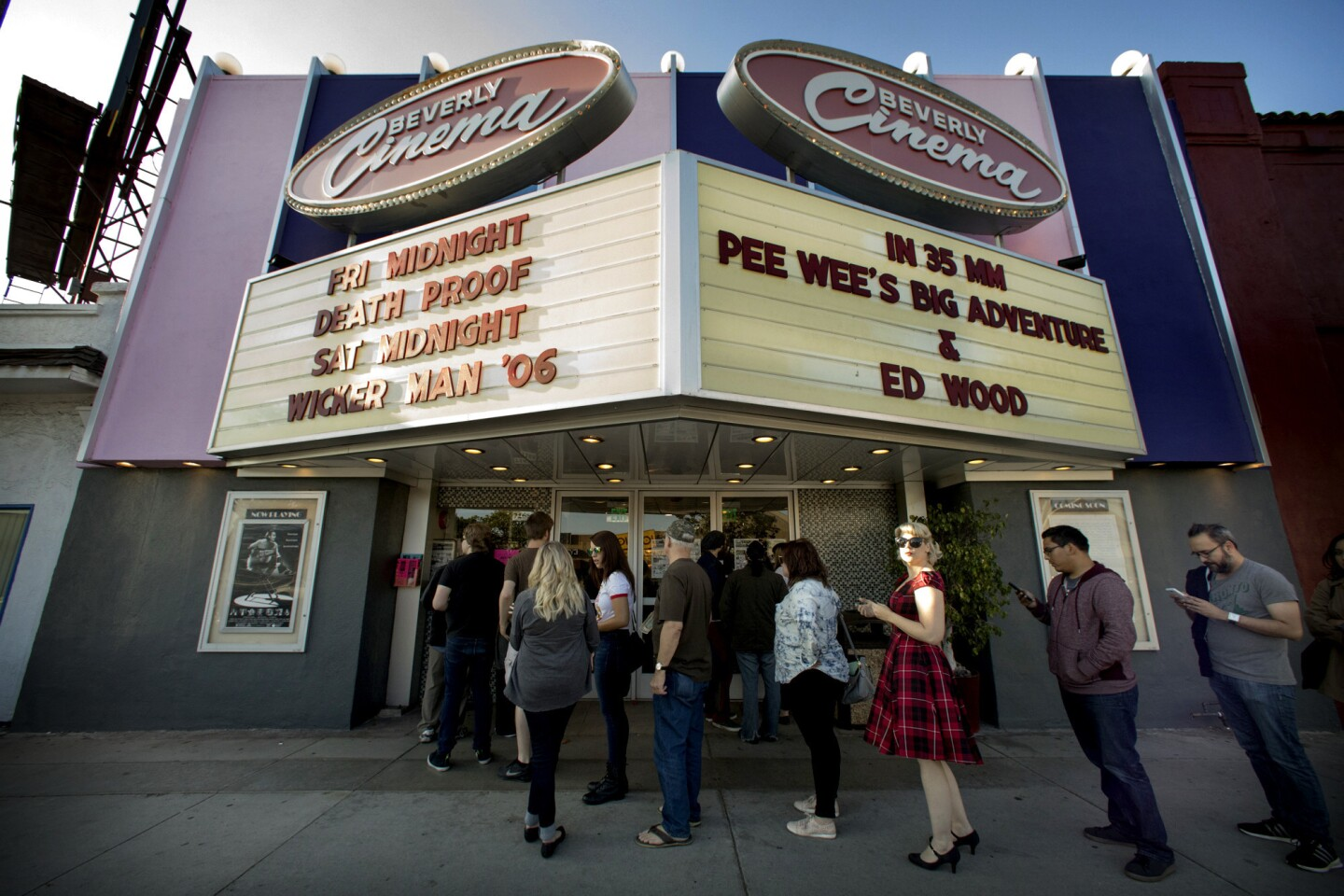 """Moviegoers at the New Beverly Cinema wait in line for the Tim Burton double feature of """"Pee-wee's Big Adventure"""" and """"Ed Wood."""" The New Beverly Cinema is known for its daily screenings of 35mm films as opposed to digital formats."""