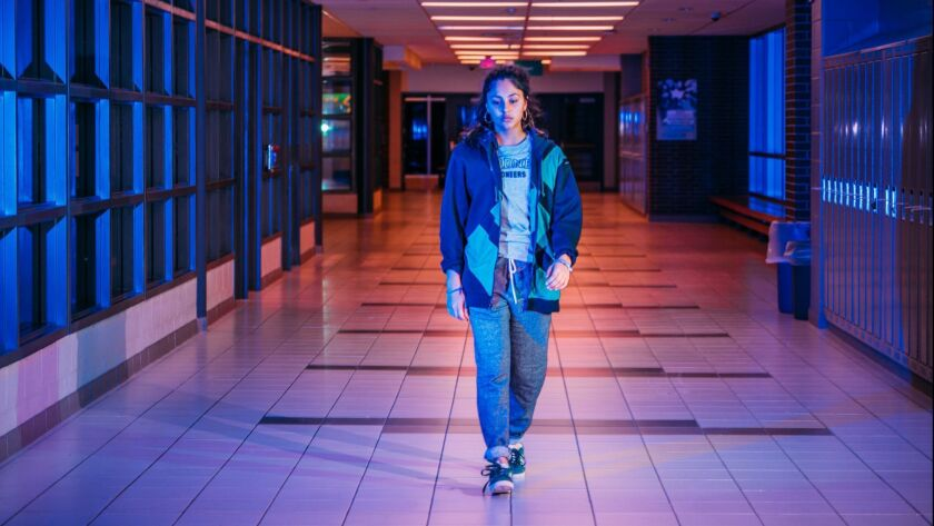"""Rhianne Barreto walks down a high school hall in """"Share."""""""