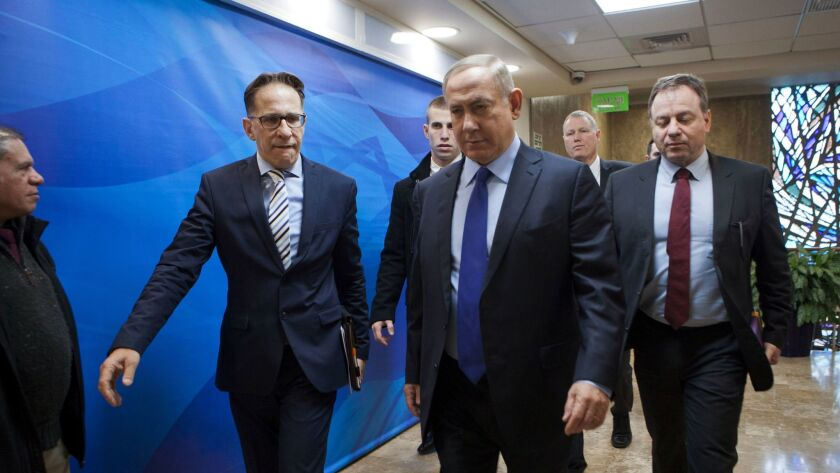 Israeli Prime Minister Benjamin Netanyahu, second right, arrives for a weekly Cabinet meeting in Jerusalem on Dec. 25, 2016.