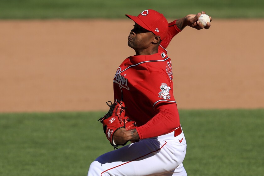 Raisel Iglesias pitches from the mound.