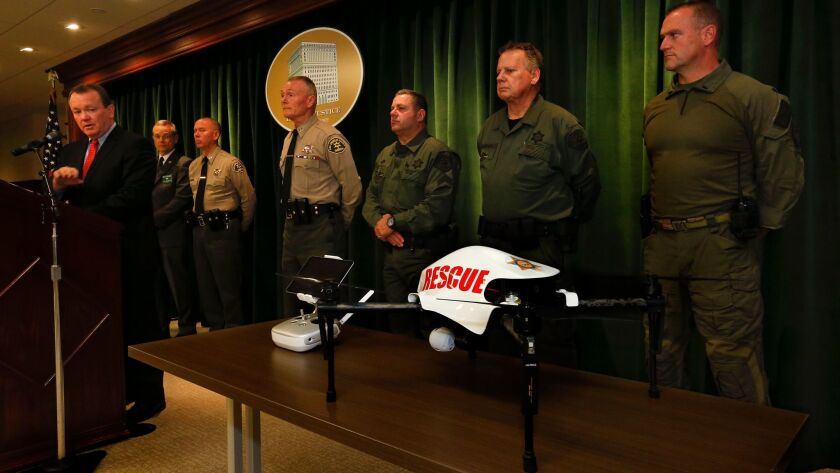 LOS ANGELES, CA-JANUARY 12, 2017: Los Angeles County Sheriff Jim McDonnell, left, holds a press con