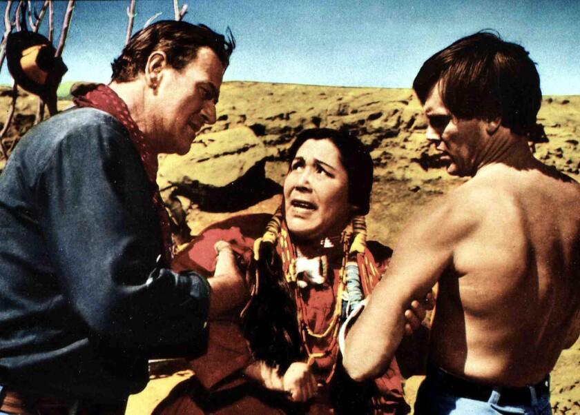 Ethan Edwards (John Wayne) and Martin Pawley (Jeffrey Hunter) confront a Native American woman (Beulah Archuletta)