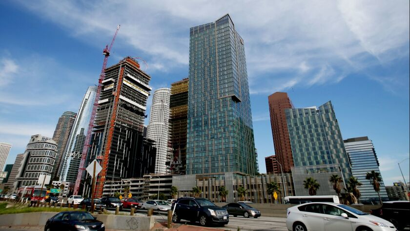 Apartment towers under construction along the Harbor Freeway at 8th Street in downtown Los Angeles.
