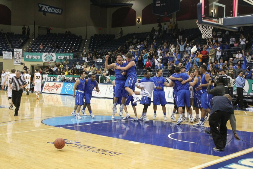 The La Jolla Country Day boys basketball team celebrates after winning the Division IV CIF title Saturday. Phil Dailey photo