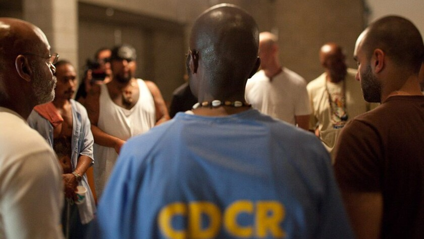 """Volunteers from the outside join inmates at Folsom Prison in the documentary """"The Work."""""""