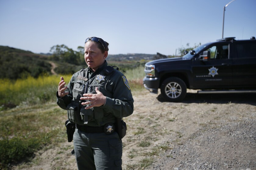 April Esconde, wildlife officer with the California Dept. of Fish and Wildlife, says mountain bikers have been cited recently in the Carlsbad Highlands Ecological Reserve on Thursday April 11, 2019. Bikes are not allowed in the reserve but there are numerous unauthorized bike trails.
