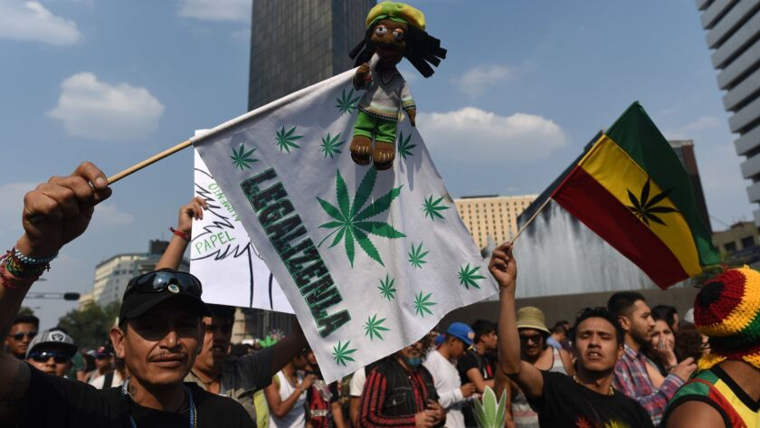 Activists march along Reforma Avenue in Mexico City on May 6, 2017, demanding the legalization of marijuana.