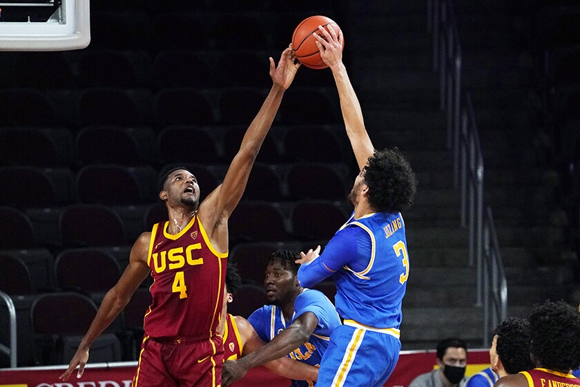 USC's Evan Mobley defends against UCLA's Johnny Juzang during a game in February.