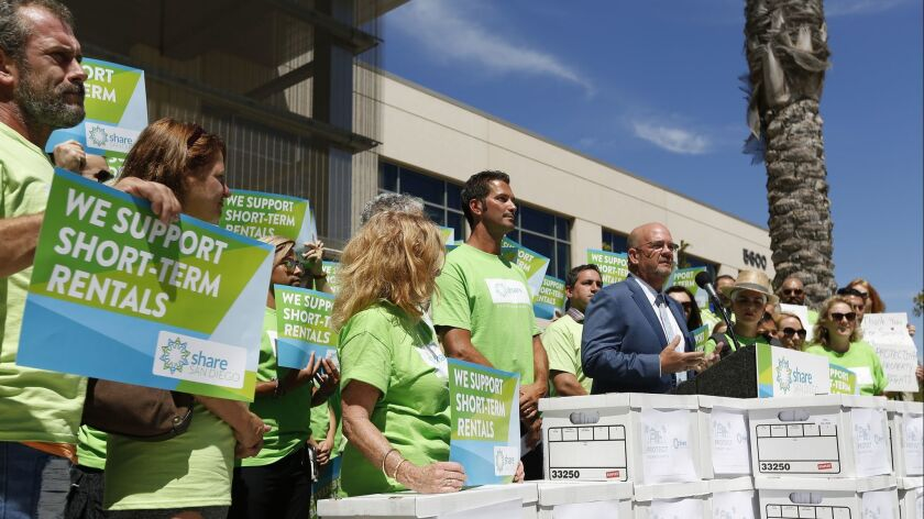 San Diego City Councilman Scott Sherman speaks at a news conference before signatures were delivered to the San Diego Registrar of Voters to qualify a referendum seeking to overturn new short-term rental regulations.