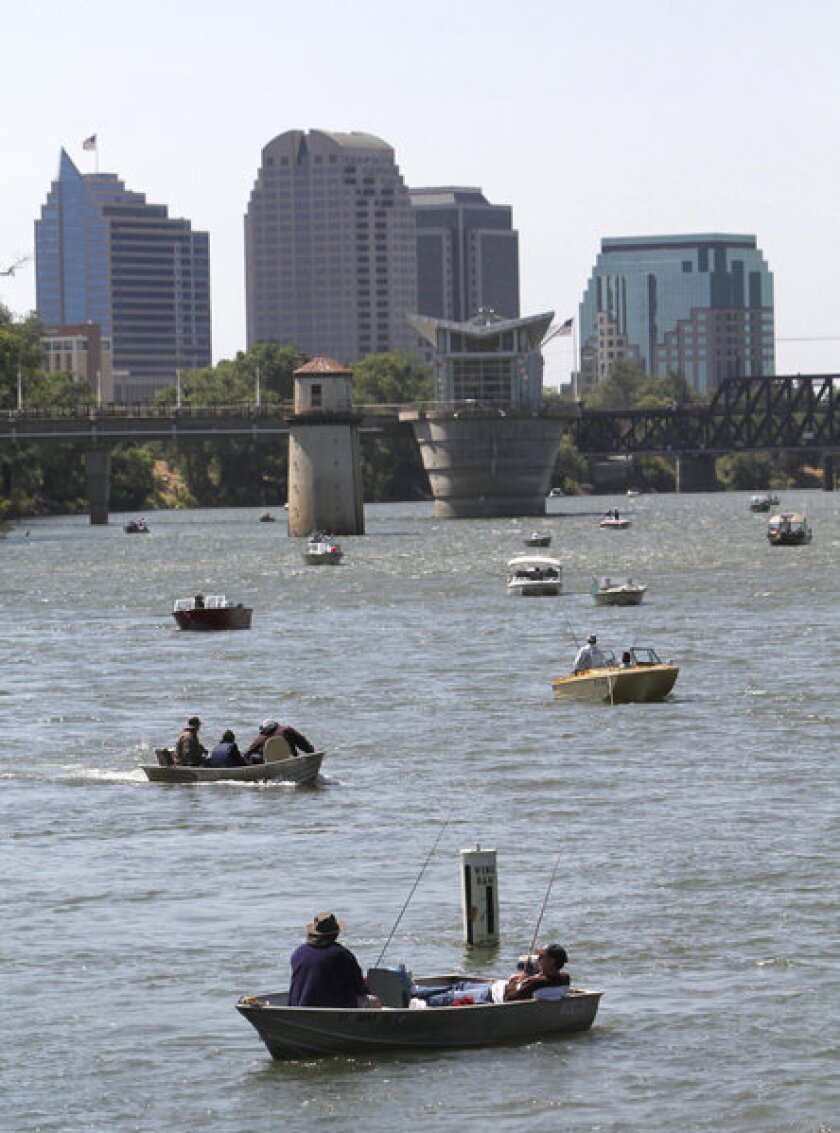 Fishermen on the Sacramento River as it flows past the state capital. The biological health of rivers and streams in the West was found to be better than in the East.