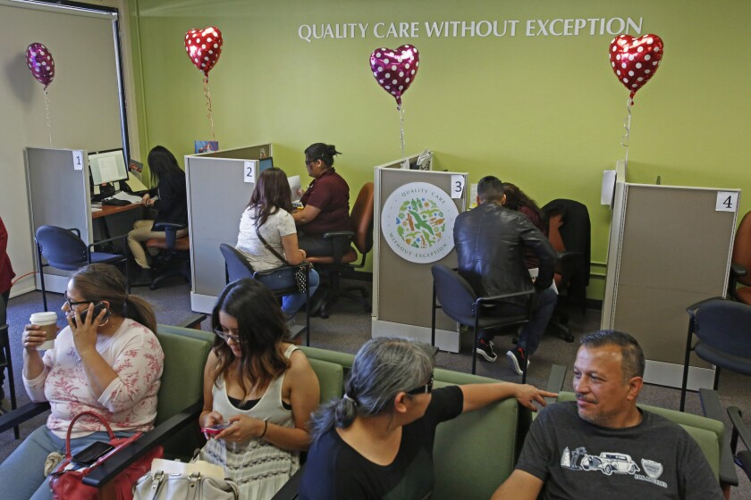 People sign up for Obamacare at AltMed Health Services in Los Angeles earlier this year.