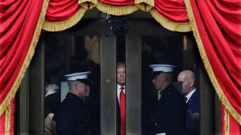 Then-President-elect Donald Trump waits to step out onto the West Front of the U.S. Capitol to be inaugurated on Jan. 20, 2017.