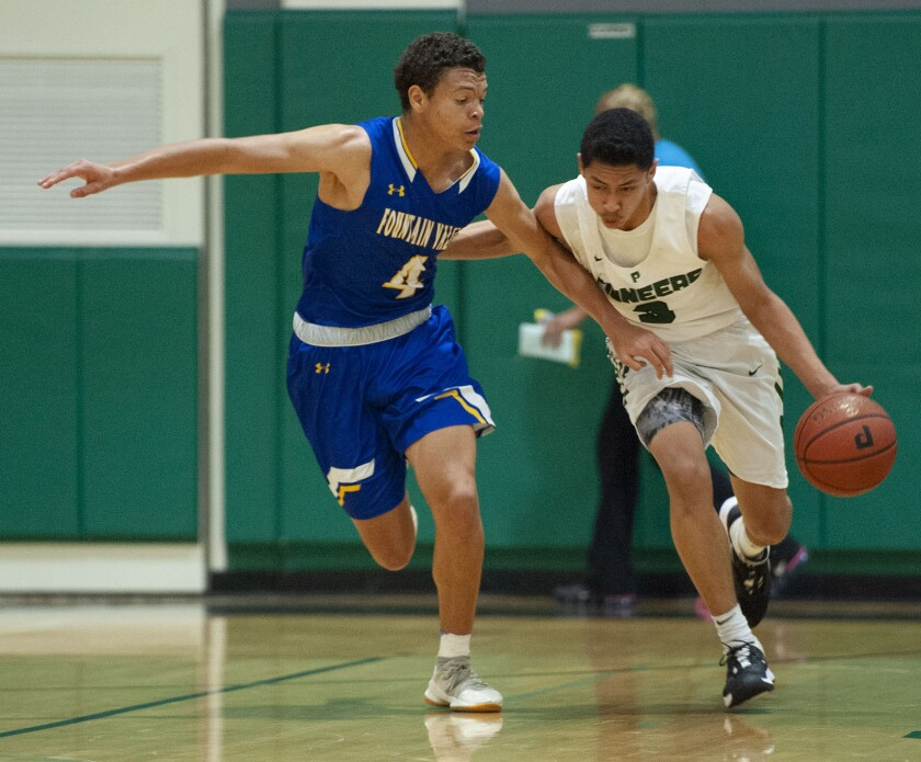 Fountain Valley's John Kubas chases Providence's Bryce Whitaker during CIF State Division III Southern California Regional semifinal at Providence High. (Photo by Miguel Vasconcellos)