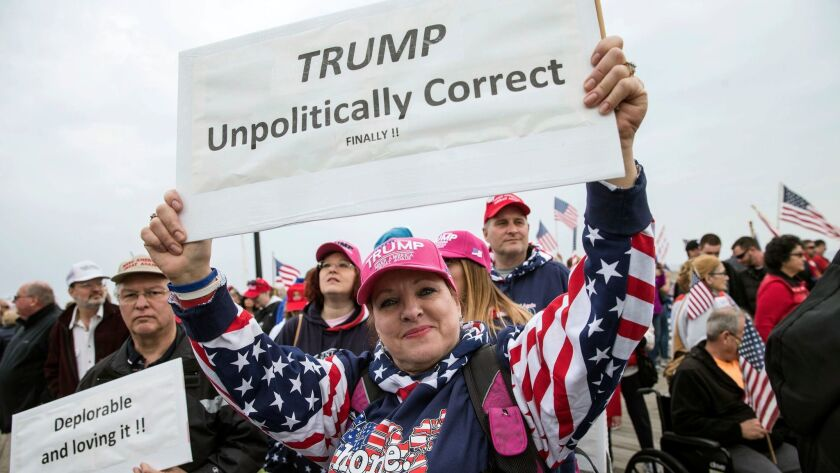 A woman shows her support for President Donald Trump during a rally in Seaside Heights, N.J., on March 25, 2017.