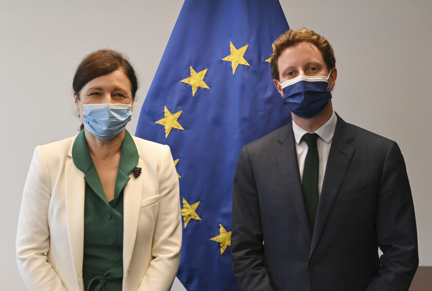 European Commissioner for Values and Transparency Vera Jourova, left, and French European Affairs Minister Clement Beaune pose for a photo before their meeting during a European general affairs ministers meeting at the European Council building in Luxembourg, Tuesday, June 22, 2021. (John Thys/Pool Photo via AP)