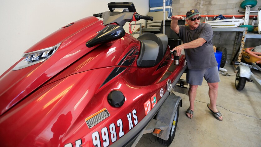 Bob Guza and his research team use GPS equipment mounted on a sand buggy and jet ski, above, to seasonally map beach levels and the impact of tides and storms.
