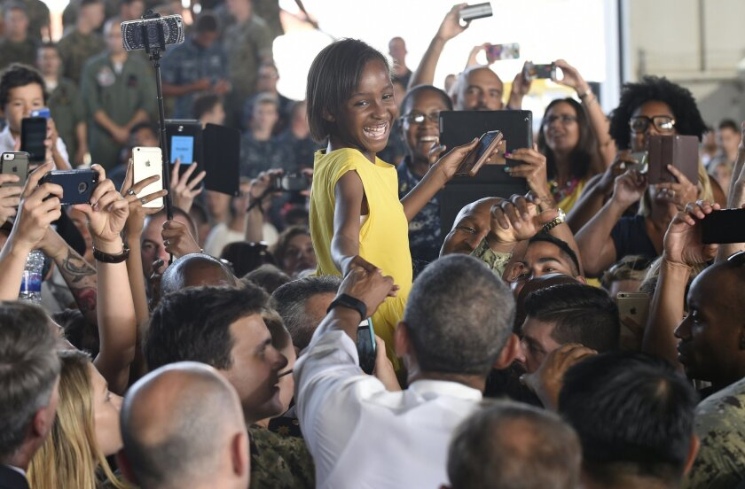 US President Barack Obama greets young girl as he meets troops, during a visit to Naval Station Rota in Cadiz, Spain, Sunday, July 10, 2016. Obama made a brief visit to Madrid and Naval Station Rota before heading back to Washington following the NATO Summit in Warsaw, Poland. (AP Photo/Susan Walsh)
