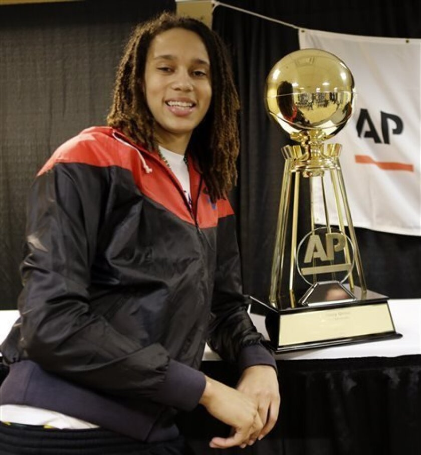 Baylor's Brittney Griner poses with her Associated Press College Basketball Player of the Year trophy after a news conference at the Women's Final Four of the NCAA college basketball tournament, Saturday, April 6, 2013, in New Orleans. (AP Photo/Gerald Herbert)
