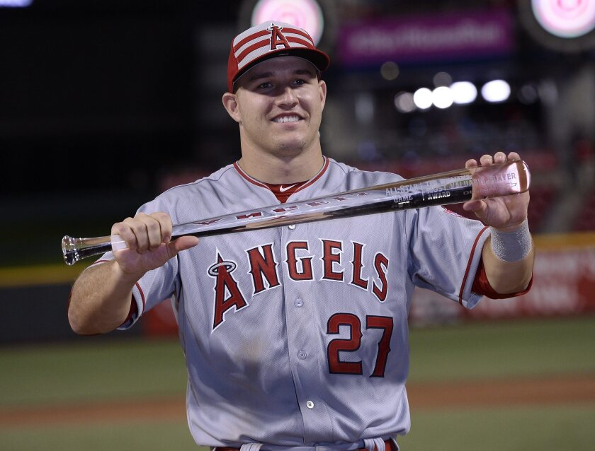 Mike Trout holds up the All-Star game most-valuable-player award on July 14.