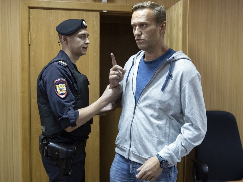 Russian opposition leader Alexei Navalny gestures while speaking in a court room in Moscow, Russia, Monday, Aug. 27, 2018.