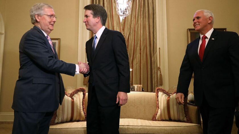 Senate Majority Leader Mitch McConnell shakes hands with Judge Brett Kavanaugh as he arrives with Vice President Mike Pence in Washington on July 10.