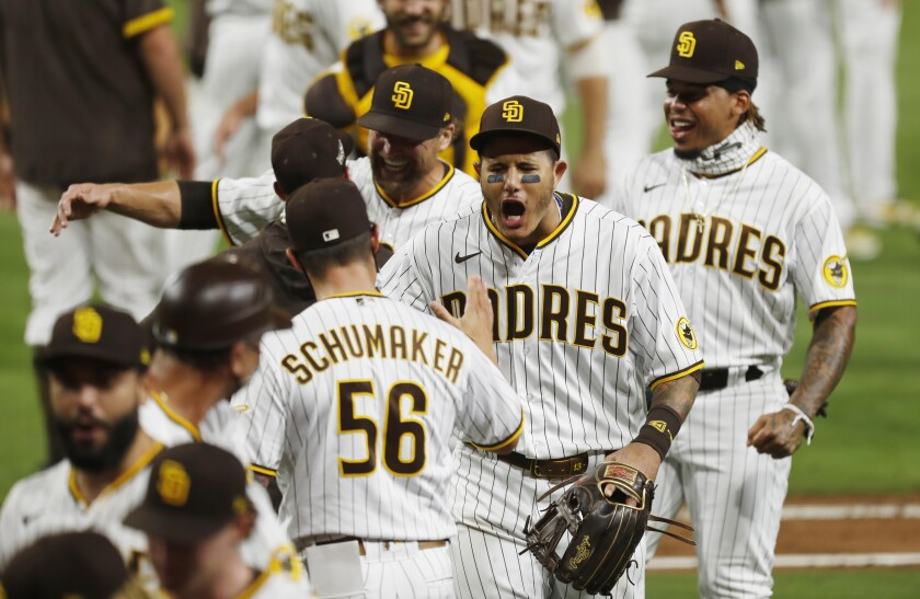 The Padres' Manny Machado celebrates with teammates after San Diego beat St. Louis on Oct. 2, 2020.