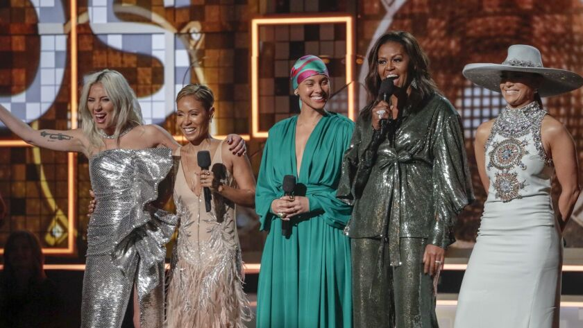 From left to right, Lady Gaga, Jada Pinkett Smith, host Alicia Keys, Michelle Obama and Jennifer Lopez onstage at the 61st Grammy Awards.