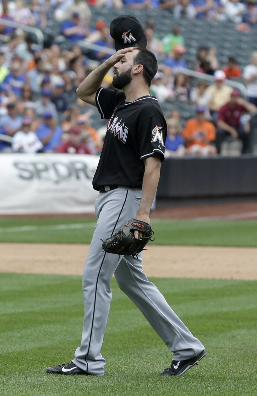 Miami Marlins relief pitcher Chris Hatcher reacts after walking New York Mets' David Wright with the bases loaded during the eighth inning of the baseball game at Citi Field, Sunday, July 13, 2014 in New York. The Mets defeated the Marlins 9-1. (AP Photo/Seth Wenig)