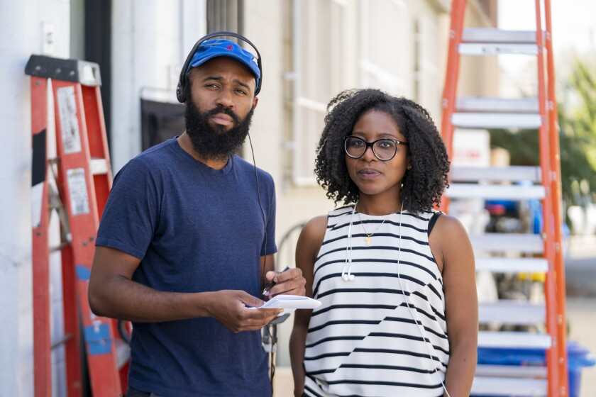 """Writer Phil Augusta Jackson and producer Amy Aniobi on the set of HBO's """"Insecure."""""""