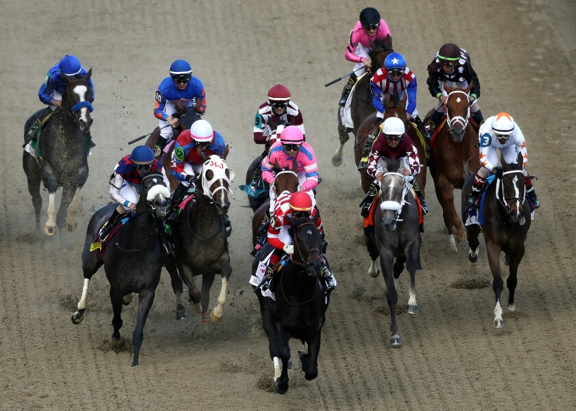 Serengeti Empress, ridden by jockey Jose Ortiz, leads the field on the way to a wire-to-wire win Saturday in the Kentucky Oaks at Churchill Downs in Louisville, Ky. Favored Bellafina, back and near-right with jockey Flavien Prat in red, white and blue racing silks, finished fifth.