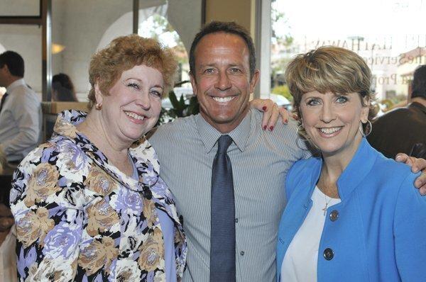 Dana Rubottom, David Skarman, Berkshire Hathaway Home Services Senior VP and General Manager Mary Lee Blaylock