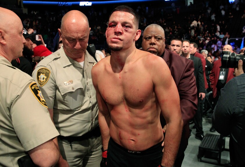 Nate Diaz leaves the octagon after his majority-decision loss to Conor McGregor at UFC 202 on Saturday.