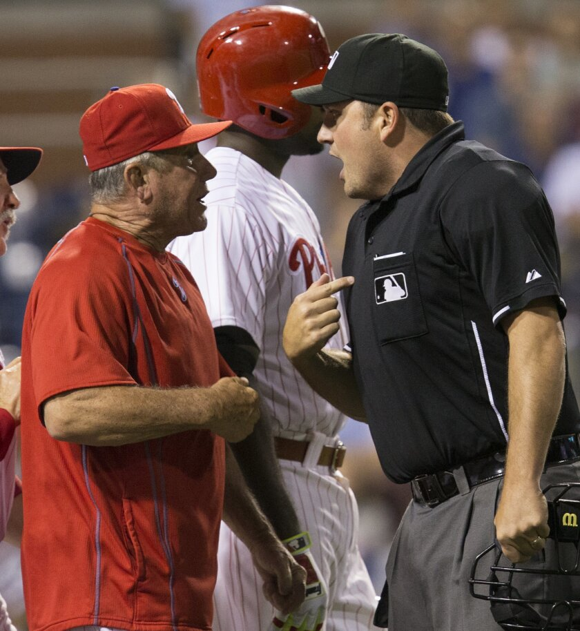 Home plate umpire Dan Bellino ejects Philadelphia Phillies bench coach Larry Bowa after he disputed a quick pitch by New York Mets relief pitcher Hansel Robles with Darin Ruf at bat in the seventh inning of a baseball game, Tuesday, Aug. 25, 2015, in Philadelphia. The Mets won 6-5. (AP Photo/Laurence Kesterson)