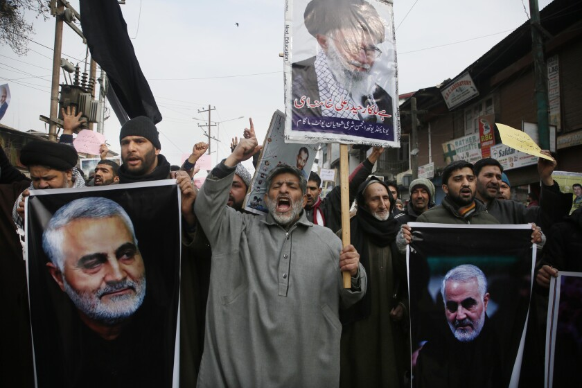 Kashmiri Shiite Muslims shout anti-American and anti-Israeli slogans during a protest against U.S. airstrikes in Iraq.