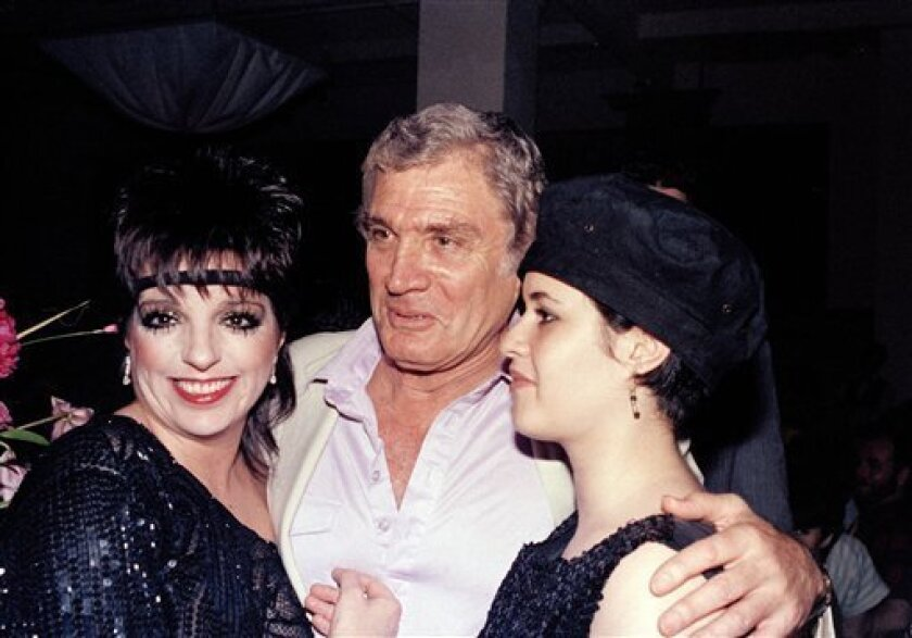 "FILE - In this June 9, 1984 file photo, entertainer Liza Minnelli, left, is shown with actor Gene Barry and his daughter Liza Barry during a party hosted by Minnelli in New York. Gene Barry, who played the well-dressed man of action in the television series ""Bat Masterson,"" ""Burke's Law"" and ""The Name of the Game,"" has died. He was 90. (AP Photo, File)"