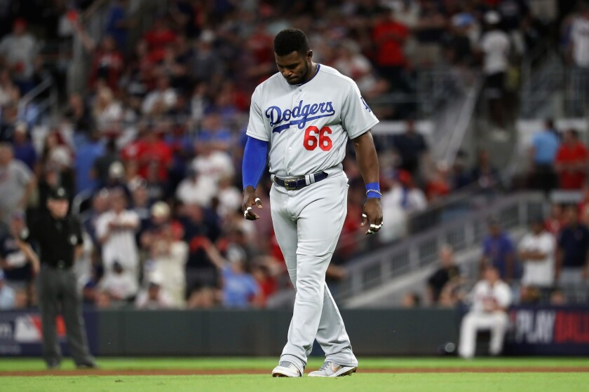Yasiel Puig #66 of the Los Angeles Dodgers reacts after grounding out in the eighth inning against the Atlanta Braves during Game Three of the National League Division Series at SunTrust Park on October 7, 2018 in Atlanta, Georgia.