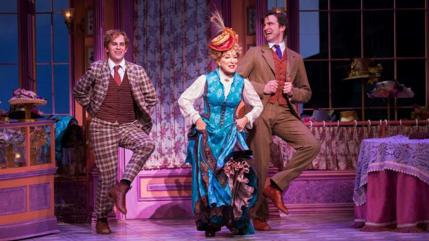 Midler flanked by Taylor Trensch, left, and Gavin Creel.
