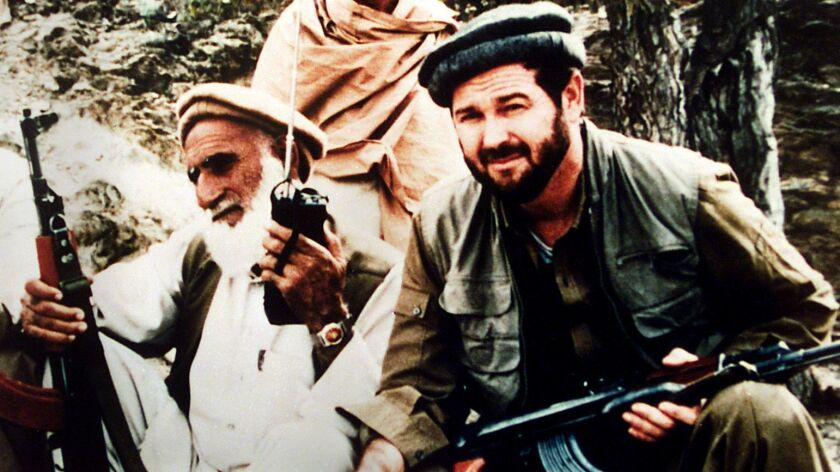 Rep. Dana Rohrabacher, right, is shown during his visit to Afghanistan shortly after he was first elected to Congress.