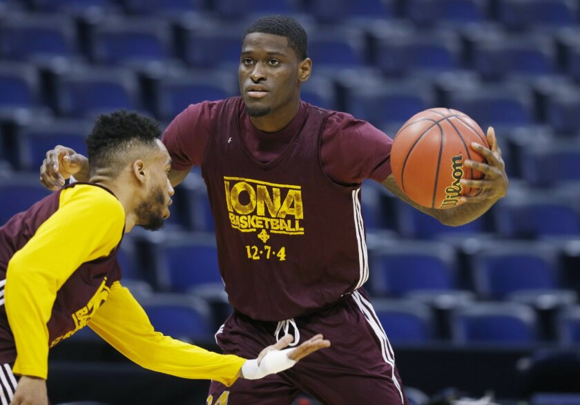 Iona guard Ibn Muhammad, left, defends against guard A.J. English during practice for a first-round men's college basketball game in the NCAA Tournament, Wednesday, March 16, 2016, in the NCAA Tournament in Denver. (AP Photo/David Zalubowski)