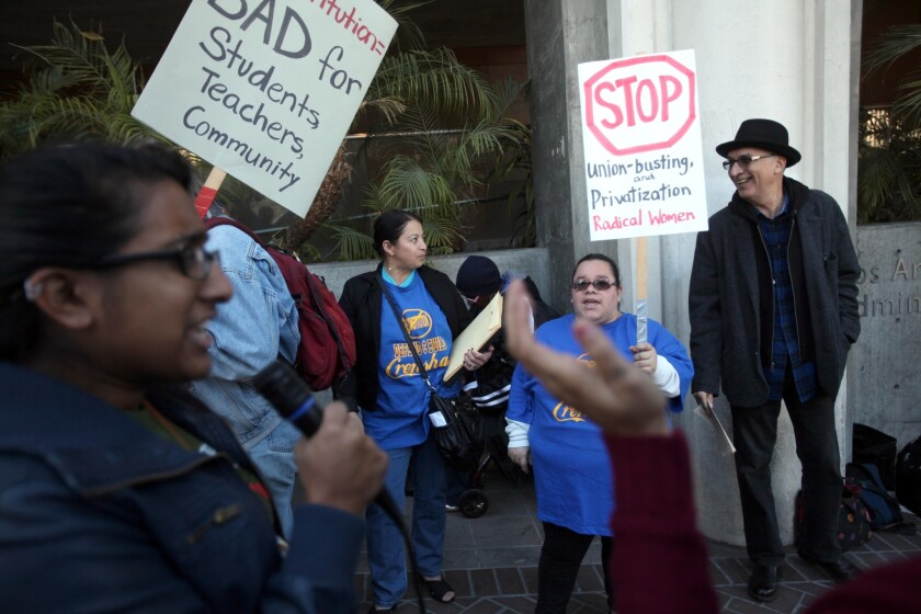 Parents, students and teachers rally in front of L.A. Unified headquarters to protest a proposal to restructure low-performing Crenshaw High School. Shruti Purkayastha, left, leads a small group of protesters outside the district headquarters.