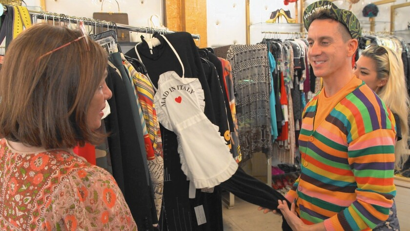 "The Way We Wore's Doris Raymond, left, helps fashion designer Jeremy Scott at the Los Angeles vintage clothing store in ""L.A. Frock Stars."""